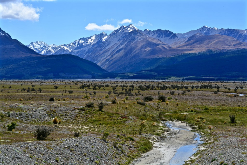 Riverbed in front of a mountain range